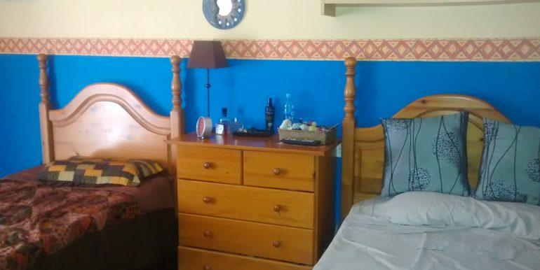 dormitorio-vivienda-tres-habitaciones